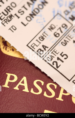 International travel concept passport and passenger flight boarding card airplane ticket - Stock Photo