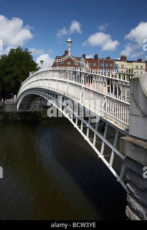 halfpenny hapenny bridge over the river liffey in the centre of dublin city republic of ireland - Stock Photo