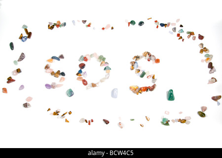Spelling out S.O.S with stones the international rescue call - Stock Photo