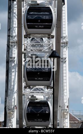 Three 'empty gondolas' on a newly constructed 'Ferris wheel' - Stock Photo