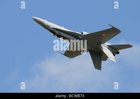 Swiss Air Force McDonnell Douglas F18 Hornet inverted during its display at the 2009 Royal International Air Tattoo - Stock Photo
