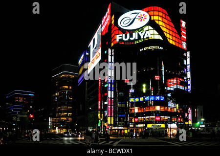 Colourful shop fronts and advertisements screens in Ginza district Tokyo Japan - Stock Photo