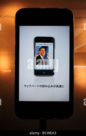 The American president Obama is seen in an Apple IPhone smartphone displayed in a cellular phone shop Tokyo Japan - Stock Photo