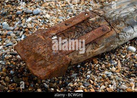 Large piece of driftwood on shingle beach, Aldeburgh, Suffolk, UK. - Stock Photo