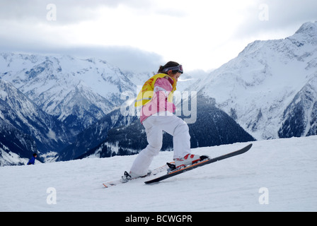 young girl in ski gear on mountain slope Zillertal Tirol - Stock Photo