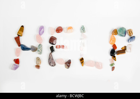 New age crystals and gemstones spelling out Help - Stock Photo