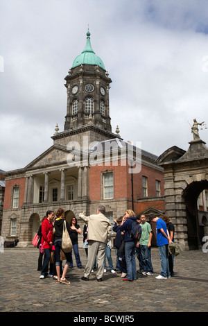 organised tour group of tourists in the the great courtyard upper courtyard in front of the bedford tower in dublin - Stock Photo