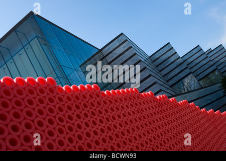 East Wing of Cleveland Museum of Art visible behind sculpture or red foam Cleveland Ohio - Stock Photo