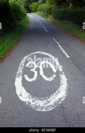 A thirty miles per hour speed restriction sign painted on a country lane near the village of Hillpool, Worcestershire, - Stock Photo