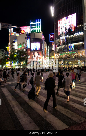 Pedestrians crosing  the street in Shibuya commercial district Tokyo Japan - Stock Photo