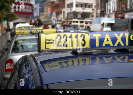 taxi in taxi rank on st stephens green in dublin city centre republic of ireland - Stock Photo