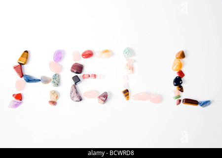 New age crystals and gemstones spelling out HELL - Stock Photo