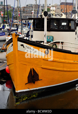 Brightly painted boat in Torquay harbour - Stock Photo