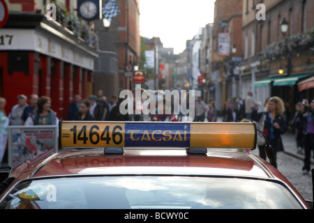 taxi with irish spelling tacsai on for hire board waiting for a fare in temple bar area in dublin city - Stock Photo