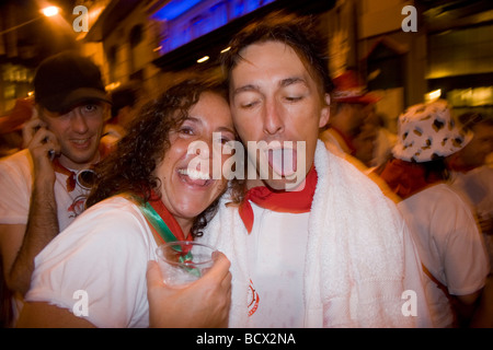 Revelers at the San Fermin 'Running of the Bull' Festival in Pamplona, Spain. - Stock Photo