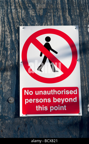 no unauthorised persons beyond this point sign rustic weathered wood background - Stock Photo