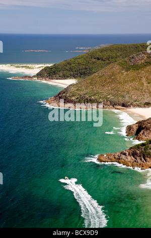 Speed Boat tour passing Zenith Beach Tomaree National Park Australia - Stock Photo