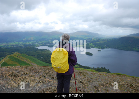 Elderly lady looking at view from Cat Bells of Derwentwater, Lake District, Cumbria, England - Stock Photo