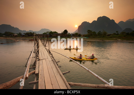 tourists canoeing on the Nam Song River at Vang Vieng, Laos - Stock Photo