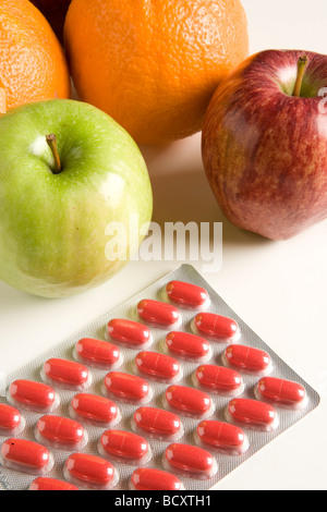 blister pack of pills and fruits - Stock Photo