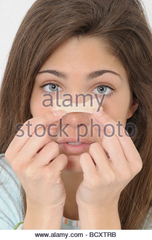 young woman with adhesive bandage - Stock Photo