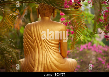 a statue of Buddha in a garden, Luang Prabang, Laos - Stock Photo