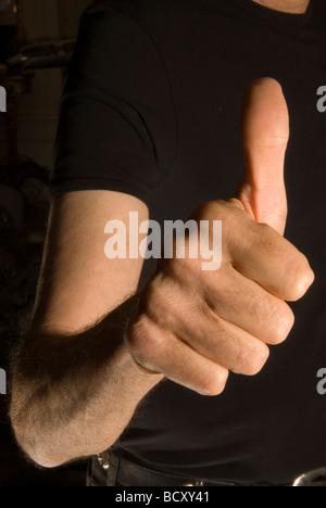Thumbs up Uri Geller at home Berkshire England PHOTO HOMER SYKES - Stock Photo