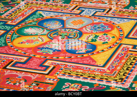 Vibrant sand mandala - Stock Photo