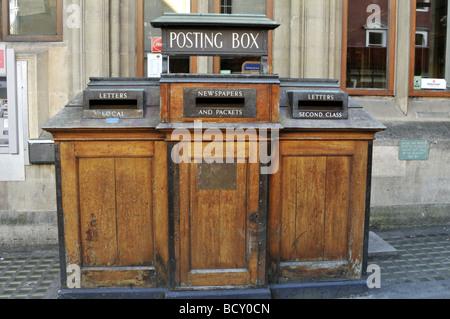 Wooden posting box, Oxford, UK. - Stock Photo