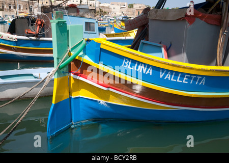 Close up of the bow of a traditional colourful Maltese boat or Luzzu, Marsaxlokk harbour, Malta - Stock Photo