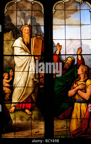 Detail of Stained Glass Window  depicting Moses and the Ten Commandments in Peterhouse College Chapel, Cambridge - Stock Photo
