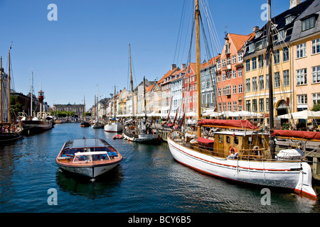 Sailing tour boat in Nyhavn Canal, Copenhagen, Denmark - Stock Photo