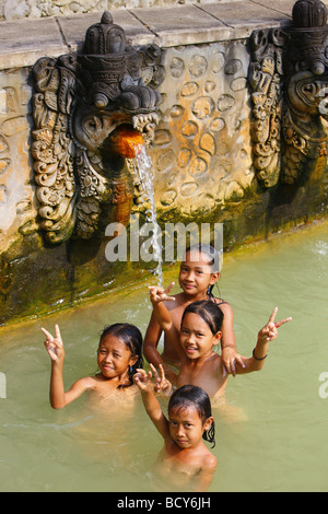 Girls, old bath with hot springs in Ambengan, Bali, Republic of Indonesia, Southeast Asia - Stock Photo