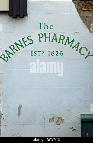 sign for the still functioning barnes pharmacy, established 1826, in barnes, southwest london, england - Stock Photo