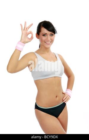 Sportliche junge Frau posiert in Sportdress sporty young woman posing in sportdress - Stock Photo