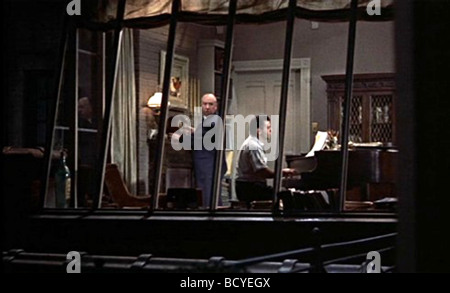 Rear Window Year : 1954 Director : Alfred Hitchcock Ross Bagdasarian - Stock Photo