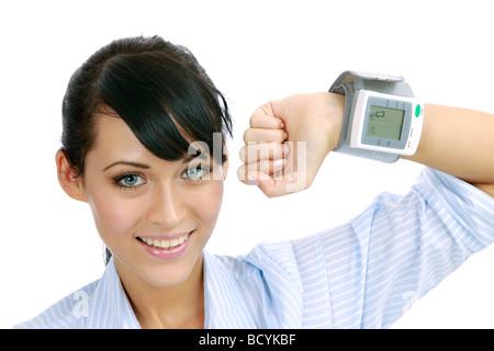 Frau misst ihren Blutdruck woman measures her blood pressure - Stock Photo