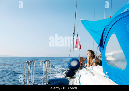 Woman Relaxing on Sailing Boat - Stock Photo