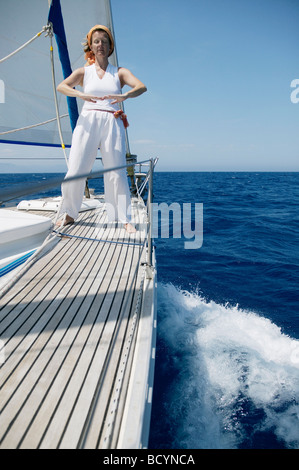 Woman doing yoga on Sailing Boat - Stock Photo