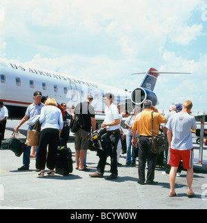 Passengers from a US Airways Express plane collecting their baggage on the tarmac at LaGuardia airport New York - Stock Photo