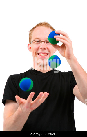 young man juggling with balls - Stock Photo