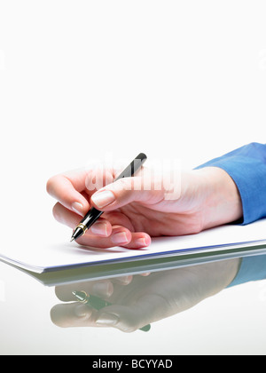 Hand of a woman, writing - Stock Photo