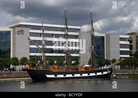the jeanie johnston 19th century replica irish sailing ship moored at dublin city moorings in the docklands area - Stock Photo