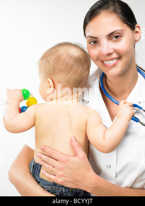 Doctor carrying baby boy - Stock Photo
