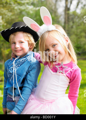 Boy and girl wearing costumes - Stock Photo