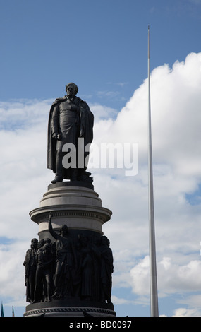 the daniel oconnell memorial statue at the end of oconnell street with the dublin spire in the background dublin - Stock Photo