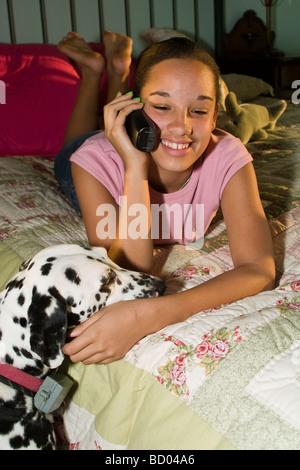 teenage girl training her dog Stock Photo: 20032848
