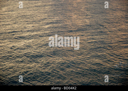 sunlight on sea, at dawn - Stock Photo