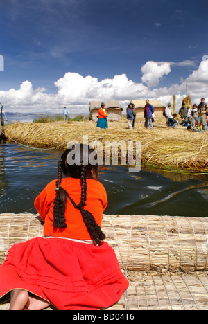 Girl from one of Uros floating islands, in lake Titicaca, Peru - Stock Photo