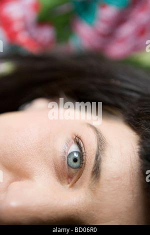 close up of woman's eye, wide awake, looking at camera - Stock Photo